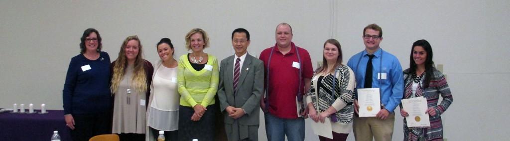 Group photo of Kappa Delta Pi members, Dean Hanfu Mi, Claudia Pitchford and Dr. Ronda Mitchell