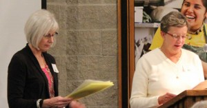 Ruth Bixby and Dr. Carolyn Peck speak to attendees at the Sigma Phi Omega Ceremony