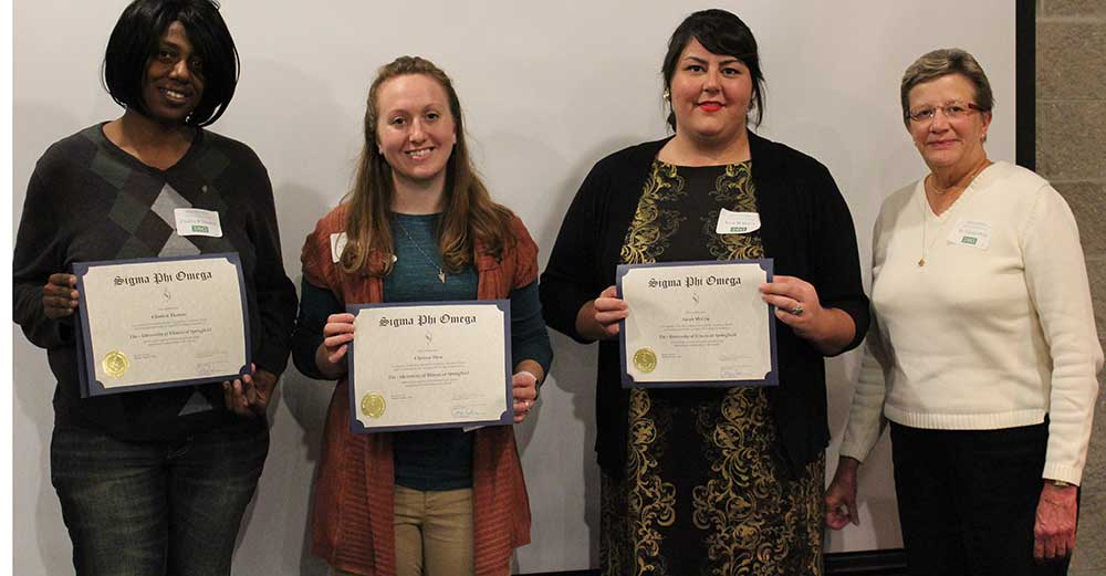 Charlon Thomas, Clarissa Shea, Sarah McCoy, Dr. Carolyn Peck pose for picture after SPO initiation ceremony